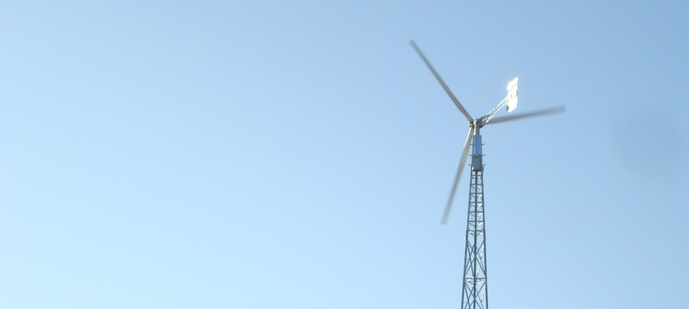 Windmill generates electricy for the farm